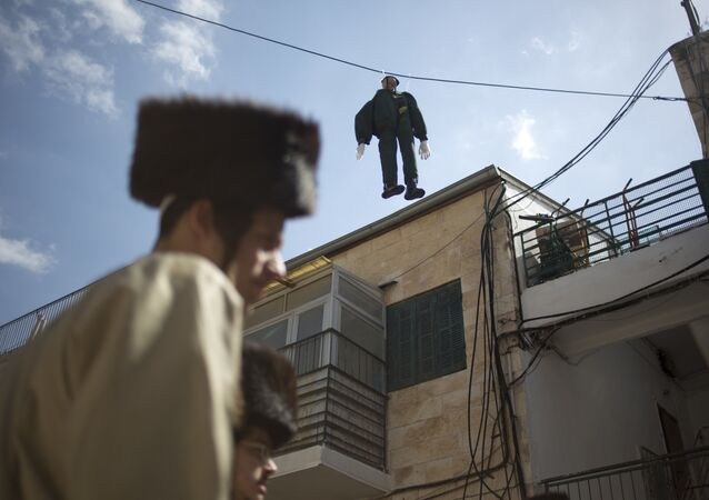 An effigy of an Israeli soldier hangs in Mea Shearim ultra-Orthodox neighborhood in Jerusalem Friday, March 2, 2018