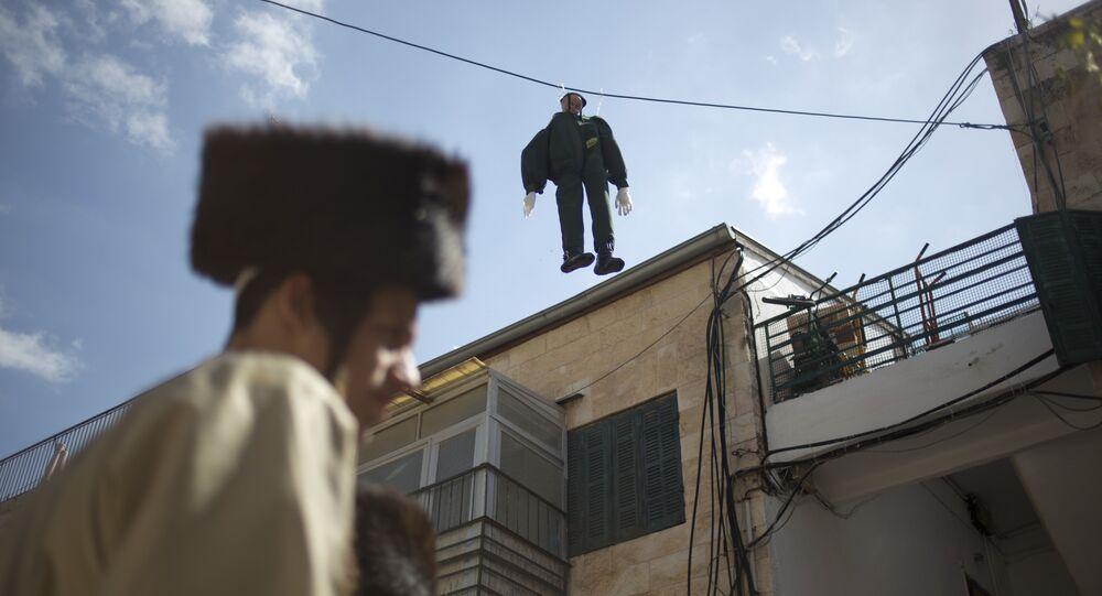 An effigy of an Israeli soldier hangs in Mea Shearim ultra-Orthodox neighborhood in Jerusalem Friday, March 2, 2018