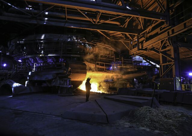 A steelworker watches as molten steel pours from one of the Blast Furnaces during 'tapping' at the British Steel - Scunthorpe plant in north Lincolnshire, north east England. (File)