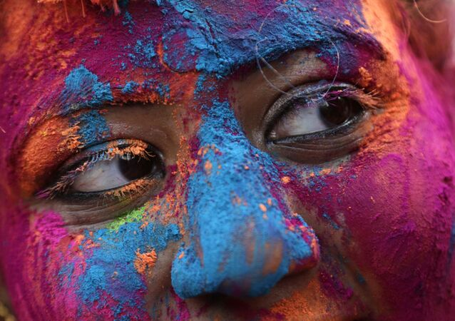 The face of a woman is smeared with colored powder during Holi, the Hindu festival of colors in Kolkata, India, Thursday, 1 March 2018.