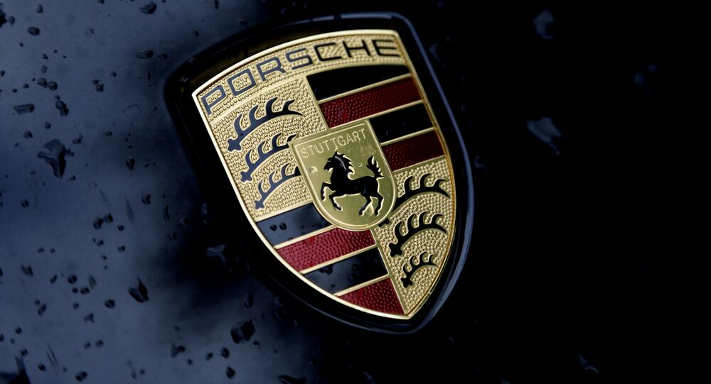The logo of German car manufacturer Porsche is rain covered at a car in Munich, Germany, Friday, July 28, 2017
