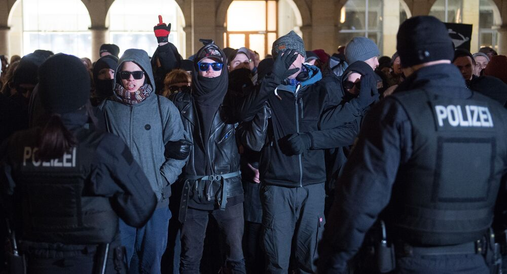 (File) Policemen face left-wings counter-demonstrators protesting against a far-right AfD (Alternative for Germany) demonstration at the old market place in Dresden, eastern Germany on February 13, 2018