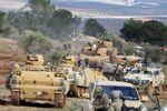 Turkish troops take control of Bursayah hill, which separates the Kurdish-held enclave of Afrin from the Turkey-controlled town of Azaz, Syria, Sunday, Jan. 28, 2018