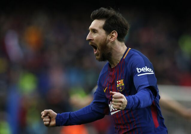 FC Barcelona's Lionel Messi reacts after scoring during the Spanish La Liga soccer match between FC Barcelona and Atletico Madrid at the Camp Nou stadium in Barcelona, Spain, Sunday, March 4, 2018