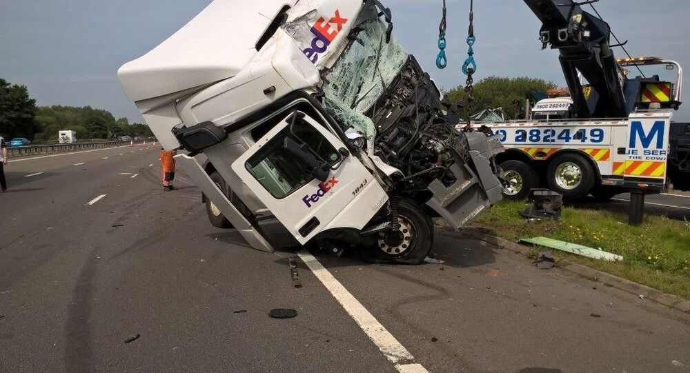 Wagstaff's Fed Ex truck (pictured) ploughed into the back of a minibus carrying 11 passengers to Disneyland Paris