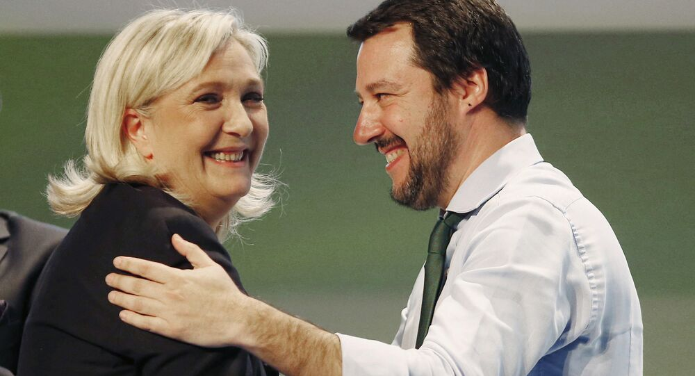 French National Front head Marine Le Pen, left, hugs Italy's Northern League leader Matteo Salvini during the Europe of Nations and Freedom movement meeting in Milan, Italy. File photo