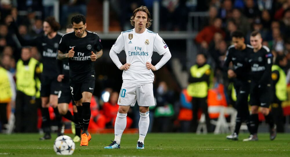 Luka Modric looks dejected as Paris St Germain players celebrate a goal but he could face jail in his native Croatia