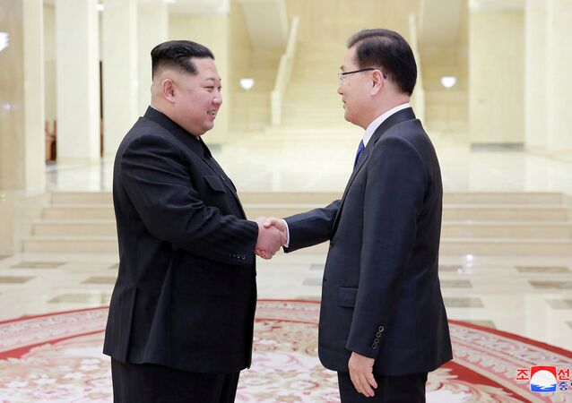 REFILE - ADDING NAME North Korean leader Kim Jong Un shakes hands with Chung Eui-yong who is leading a special delegation of South Korea's President, in this photo released by North Korea's Korean Central News Agency (KCNA) on March 6, 2018