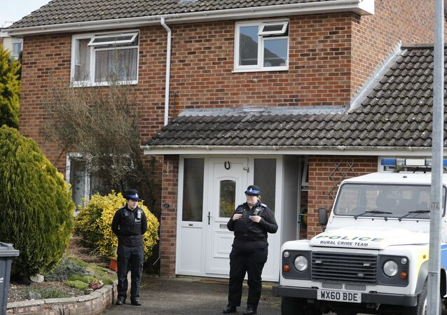 Police officers stand outside the house of Sergei Skripal in Salisbury, England, March 6, 2018