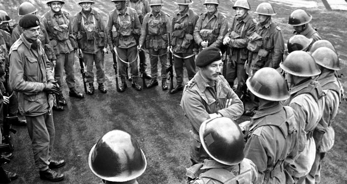 Commanding officer of the 2nd Battalion, the Queen's Regiment, Brigadier Peter Hudson briefs his men at Palace Barracks Hollywood near Belfast in Northern Ireland on April 22, 1969, before they moved out to guard vital installations in the area. The army was called in after several bombing incidents damaged water and electrical supplies to the city.