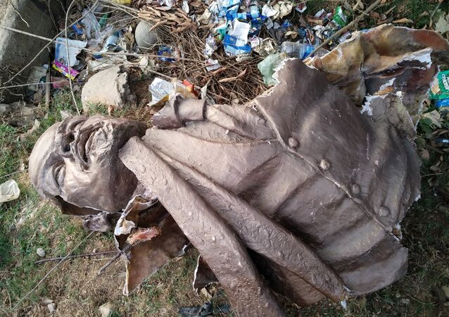 In this photo taken on March 5, 2018 the bust of a Lenin statue is seen laying on the ground after Indian supporters of Bharatiya Mazdoor Sangh, a wing of Bharatiya Janata Party, toppled the statue in Belonia, some 76 kms south of Agartala, the capital of northeastern Indian state of Tripura