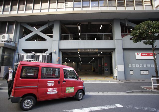 A mail delivery car returns to a post office in Tokyo (File)
