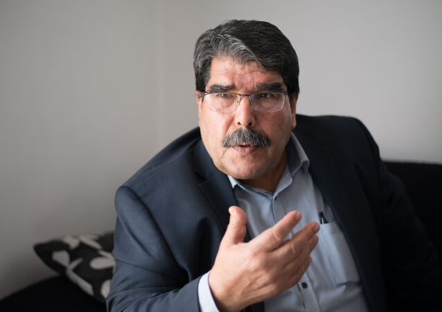 Saleh Muslim, co-president of the Syrian Kurdish Democratic Union Party (PYD), speaks during an interview in Marseille, southern France, on December 1, 2013.
