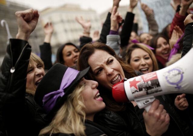 People, mostly women, shout slogans during a protest at the Sol square during the International Women's Day in Madrid, Thursday, March 8, 2018
