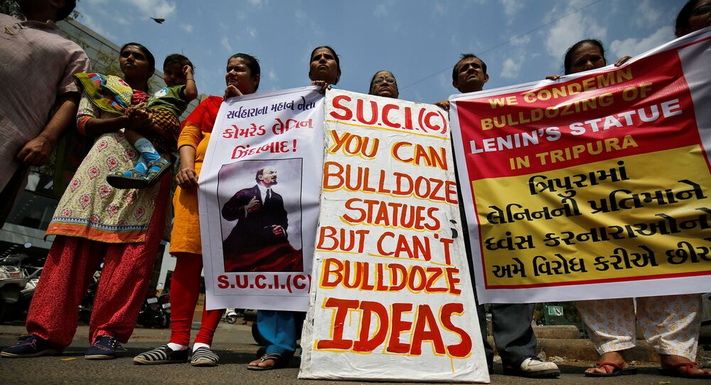 Activists of Socialist Unity Centre of India (SUCI) hold placards and shout anti-government slogans during a protest against what they say was the demolition of a statue of Vladimir Lenin in the northeastern state of Tripura on Monday, in Ahmedabad, India, March 7, 2018