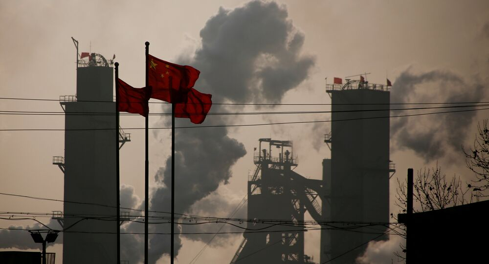 Chinese national flags are flying near a steel factory in Wu'an, Hebei province, China, February 23, 2017