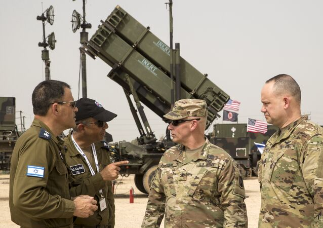 US and Israeli army officers talk in front a US Patriot missile defence system during the Israeli-US military exercise Juniper Cobra at the Hatzor Airforce Base in Israel on March 8, 2018