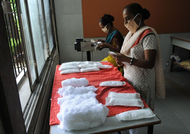 (File) Members of Self Employed Women's Association (SEWA) make low cost sanitary pads at their facility in Ahmedabad on September 3, 2012