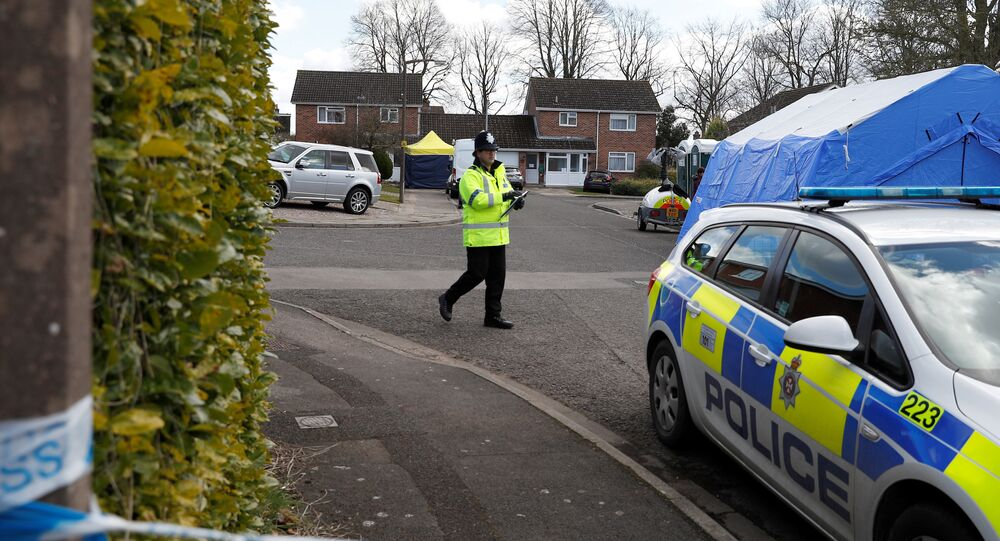 Police officers stand guard outside the home of Sergei Skripal in Salisbury, Britain, March 8, 2018
