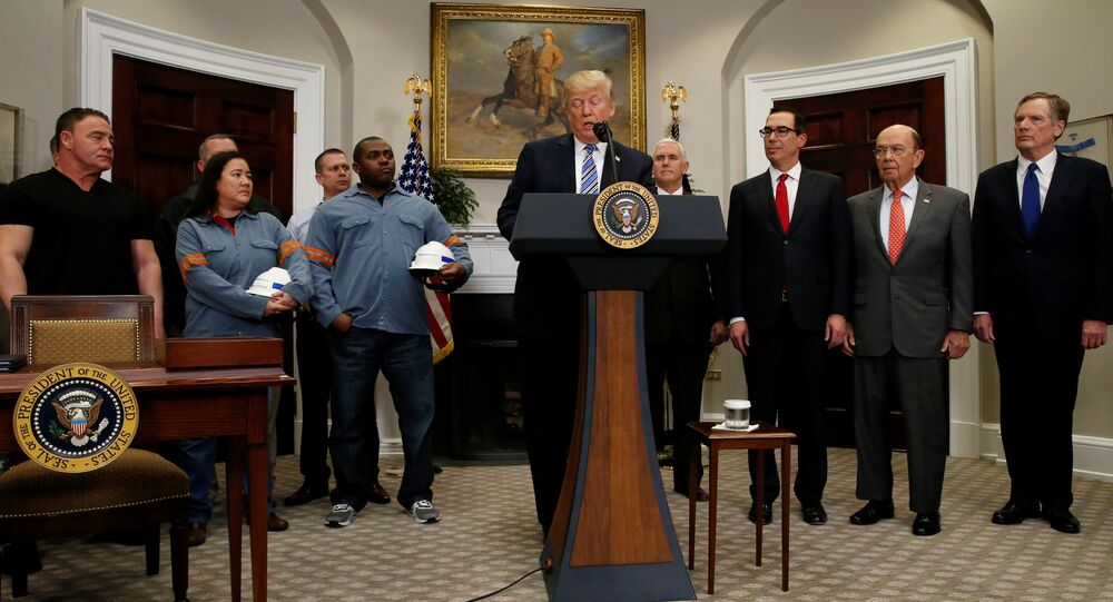 U.S. President Donald Trump announces a presidential proclamation placing tariffs on steel and aluminum imports while surrounded by workers from the steel and aluminum industries, next to Vice President Mike Pence, Treasury Secretary Steven Mnuchin, Commerce Secretary Wilbur Ross and Robert Lighthizer, United States Trade Representative, at the White House in Washington, U.S. March 8, 2018