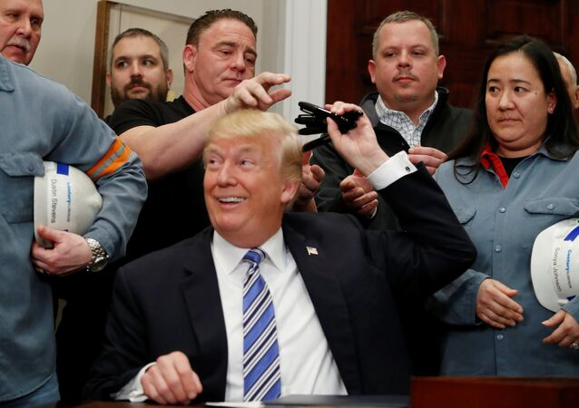U.S. President Donald Trump gives out pens he used to sign presidential proclamations placing tariffs on steel and aluminum imports to workers from the steel and aluminum industries at the White House in Washington, U.S. March 8, 2018