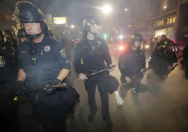 Police make a line to prevent protesters from marching in Oakland, California