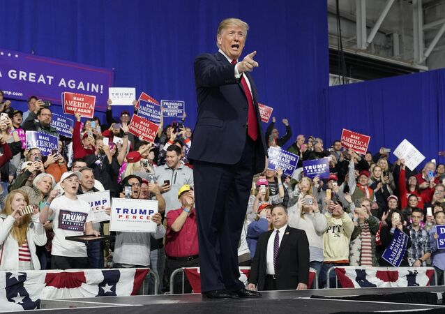 U.S. President Donald Trump points at supporters after speaking in support of Republican congressional candidate Rick Sacconne during a Make America Great Again rally in Moon Township, Pennsylvania, U.S., March 10, 2018