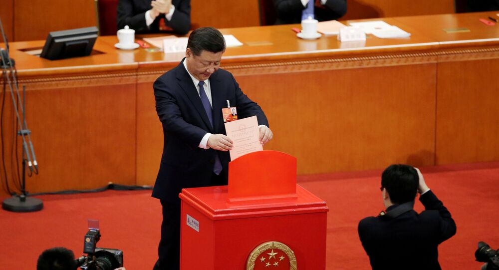 Chinese President Xi Jinping drops his ballot, during a vote on a constitutional amendment lifting presidential term limits, at the third plenary session of the National People's Congress (NPC) at the Great Hall of the People in Beijing, China March 11, 2018