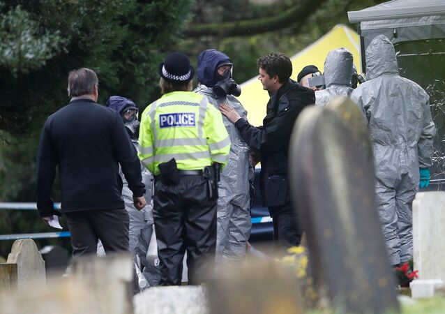 Members of the emergency services in protective suits work at the site of the grave of Luidmila Skripal, wife of former Russian inteligence officer Sergei Skripal, at London Road Cemetery in Salisbury, Britain, March 10, 2018