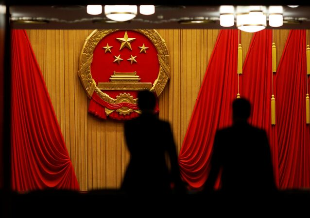 Delegates arrive to the third plenary session of the National People's Congress (NPC) at the Great Hall of the People to take a part in a vote on a constitutional amendment lifting presidential term limits, in Beijing, China March 11, 2018