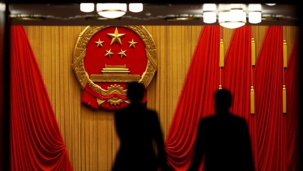 Delegates arrive to the third plenary session of the National People's Congress (NPC) at the Great Hall of the People to take a part in a vote on a constitutional amendment lifting presidential term limits, in Beijing, China March 11, 2018 - Sputnik International