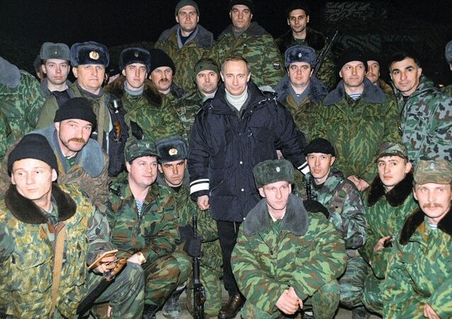 Vladimir Putin (center) with Russian soldiers in Chechnya in December 1999. File photo