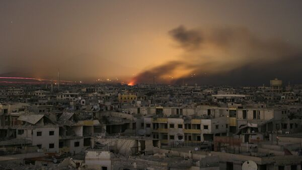 Lights and smoke are seen during Syrian government bombardment on the rebel-controlled town of Arbin, in the besieged Eastern Ghouta region on the outskirts of the capital Damascus, on late March 11, 2018 - Sputnik International