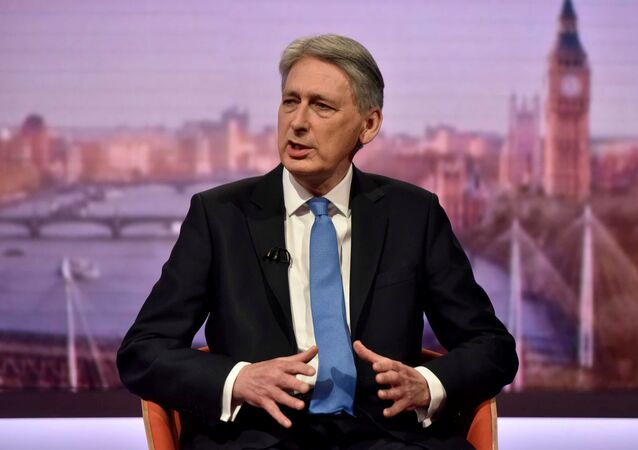 Britain's Chancellor of the Exchequer Philip Hammond attends the Marr Show at the BBC in London, March 11, 2018