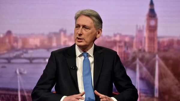 Britain's Chancellor of the Exchequer Philip Hammond attends the Marr Show at the BBC in London, March 11, 2018 - Sputnik International