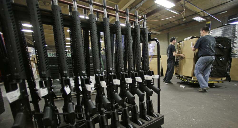 In this April 10, 2013 file photo, newly made AR-15 rifles stand in a rack at Stag Arms in New Britain, Conn.
