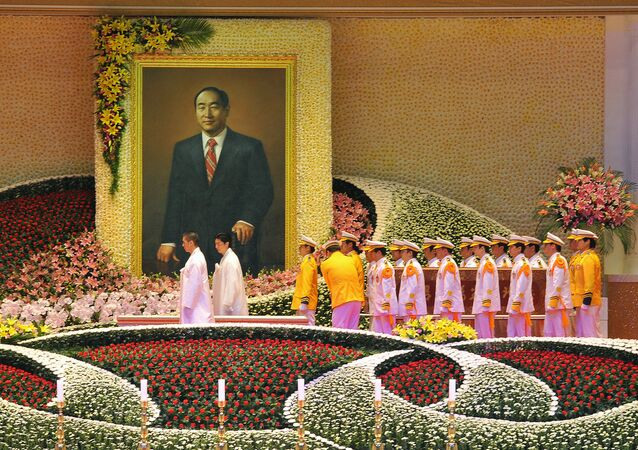 Unification Church honour guards carry the coffin (R) containing late Unification Church founder Sun Myung Moon during his funeral ceremony at the Cheongshim Peace World Center in Gapyeong, about 60 km east of Seoul, on September 15, 2012