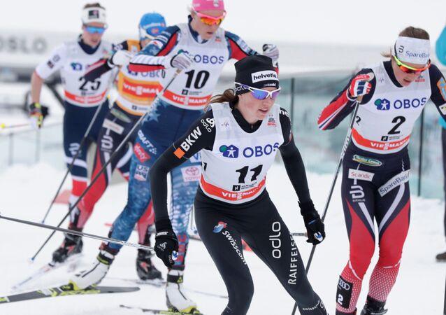FIS Cross Country World Cup - Women's 30 km Mass Start - Holmenkollen, Norway - March 11, 2018. Nathalie von Siebenthal of Switzerland and Ingvild Flugstad Oestberg of Norway compete
