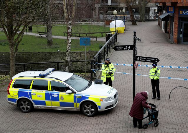 Police officers continue to guard the scene where a forensic tent, covering the bench where Sergei Skripal and his daughter Yulia were found, has been erected in the centre of Salisbury, Britain, March 9, 2018