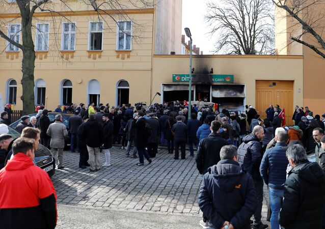 People outside a mosque after it was destroyed by a fire in Berlin, Germany, March 11, 2018