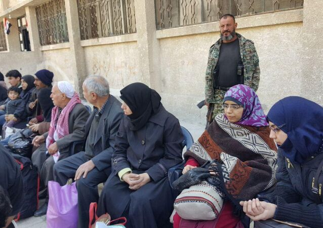 Second group of civilians left Syria's Duma located in Eastern Ghouta via a humanitarian corridor to the Muhayam al-Wafedin checkpoint