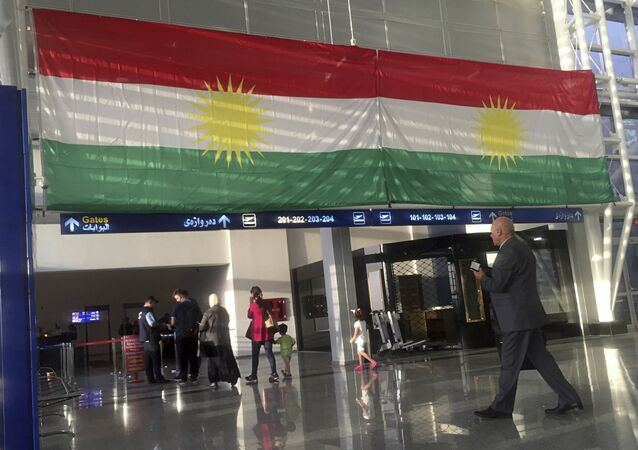 FILE - In this Sept. 27, 2017 file photo, a Kurdish flag hangs in the Irbil International Airport, Iraq. Iraqi Prime Minister Haider al-Abadi said Tuesday, March 13, 2018, that he is reopening airports in Iraq's Kurdish region to international flights after federal authority was restored at the hubs