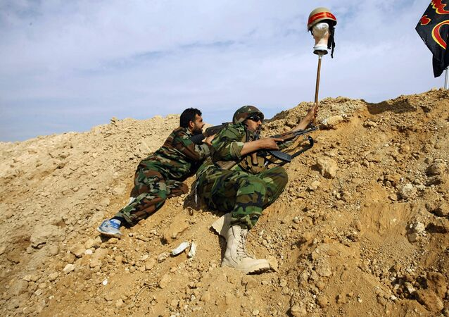 FILE - This Friday, Nov. 22, 2013 file photo, Iraqi and Lebanese Shiite fighters from a group called the Hussein Brigade use a helmet to draw a sniper into view in the town of Hejeira, in the countryside of Damascus, Syria