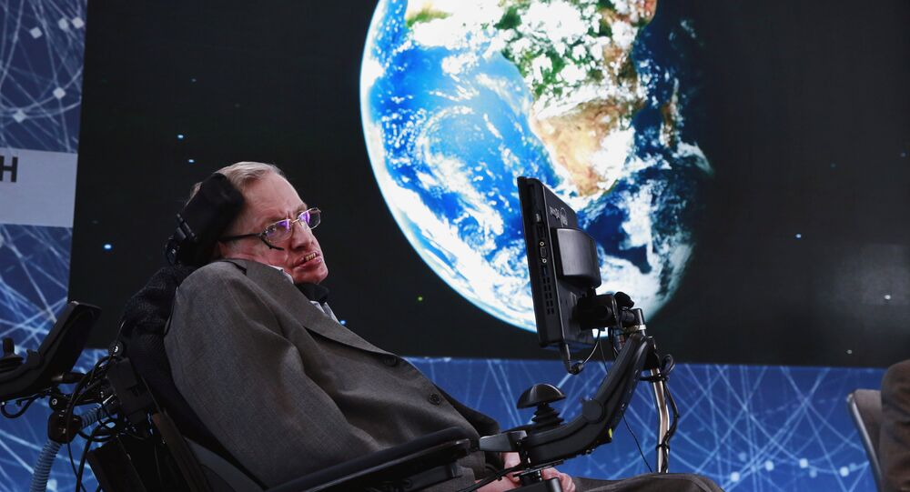 FILE PHOTO: Physicist Stephen Hawking sits on stage during an announcement of the Breakthrough Starshot initiative with investor Yuri Milner in New York April 12, 2016