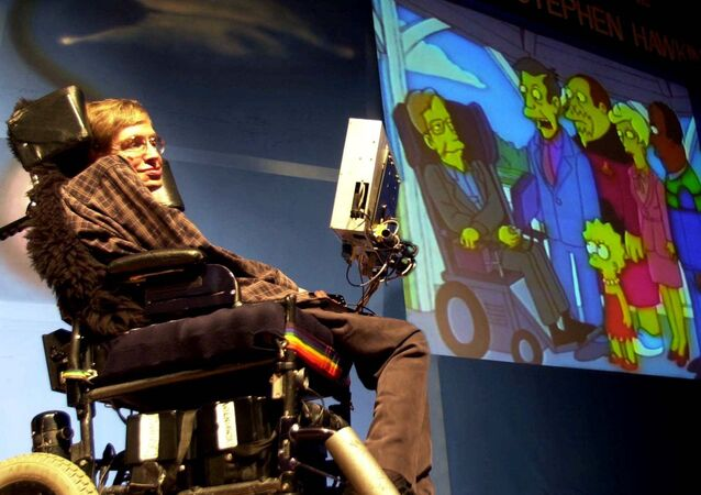 British physicist Stephen Hawking looks, on his screen, at an animated clipping of himself with cartoon characters from popular television serial 'The Simpsons', while addressing a public lecture on 'Science in the future', in Bombay Sunday, Jan. 14, 2001