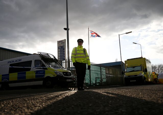 A police officer stands guard at a car recovery depot in Norton Enterprise Park, where Sergei Skripal's car was originally transported, in Salisbury, Britain, March 13, 2018