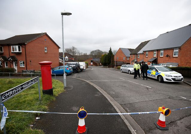 Police officers stand on duty at a road block on the road where former Russian inteligence agent Sergei Skripal lives, in Salisbury, Britain March 11, 2018