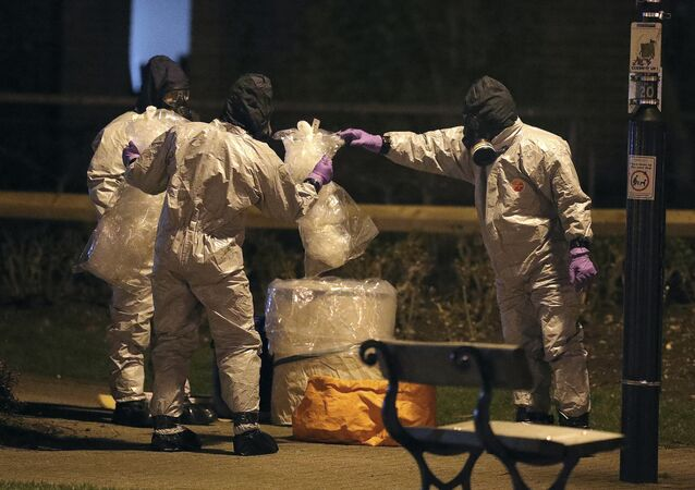 Investigators in protective suits work at the scene in the Maltings shopping centre in Salisbury, England, Tuesday, March 13, 2018
