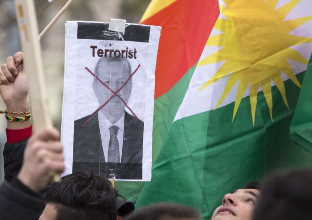 People with Kurdish flags demonstrate against Turkish president Recep Tayyip Erdogan and the political repression that followed July's failed military coup in Leipzig, Germany, Saturday, Nov. 19, 2016