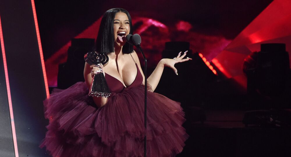Singer Cardi B accepts the Best New Artist award during the 2018 iHeartRadio Music Awards
